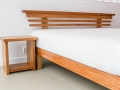 Sono Bedframe and sidetable in New Guinea Rosewood